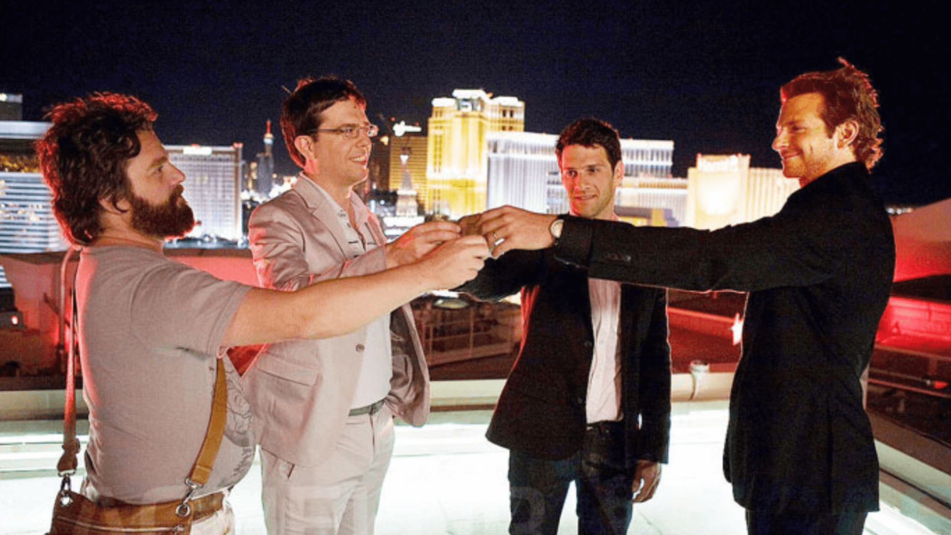 Alan making toast on rooftop of the hotel in Las Vegas that will lead to hangover.